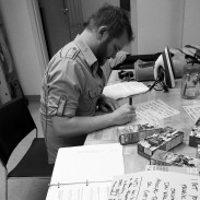 CUE CARDS--Before shooting, Randall transfers his script to cue cards. With so many MFAs cramming lines, the Archive had an energy like we were waiting for a callback.