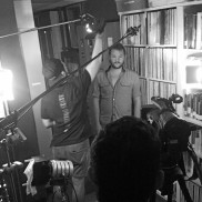 """LIGHT LEVELS--Randall waits to film his """"Fun Fact from the Back"""" segment while the crew adjusts light levels. Part of the fun of 'Broadway school' turned 'Hollywood school' was all the gear."""