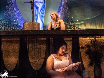 A PAIR OF QUEENS--Kristy Lozano (Victoria/Vashti) plays the deposed queen of Persia, while Julia Pottinger (Ella/Esther) portrays her successor. With the play-within-a-play device, teens portrayed both actors putting on a Purim spiel and ancient characters within the Esther story.